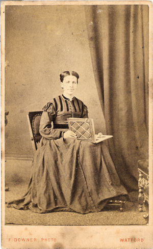 Lady with Photoalbum - by Frederick Downer, Watford